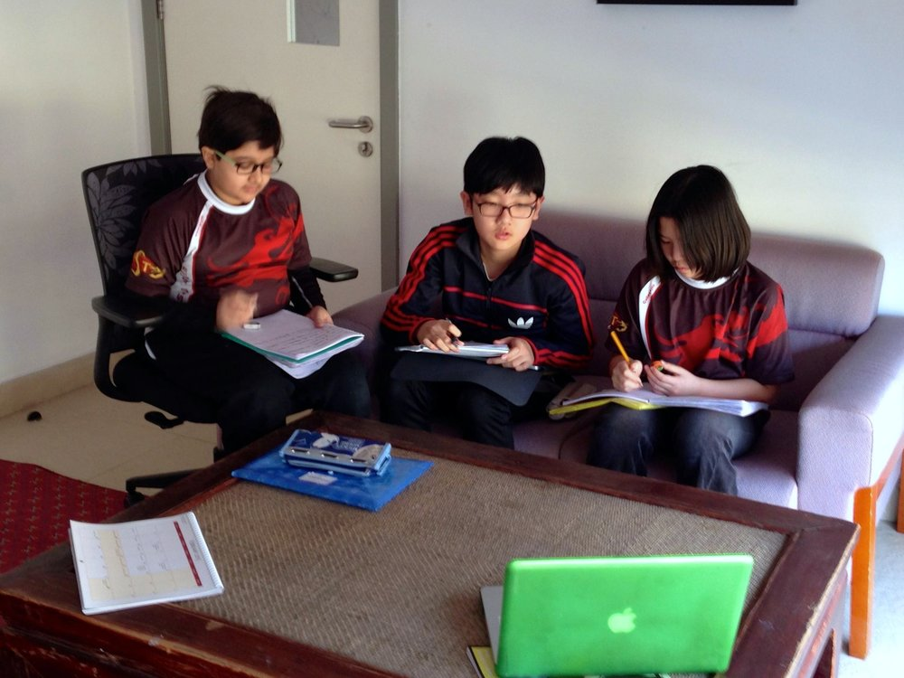 """Next-generation scientists tackle climate change during their """"Exhibition"""" independent study project at The International School of Tianjin. Photo: Diana Garcia-Lavigne"""