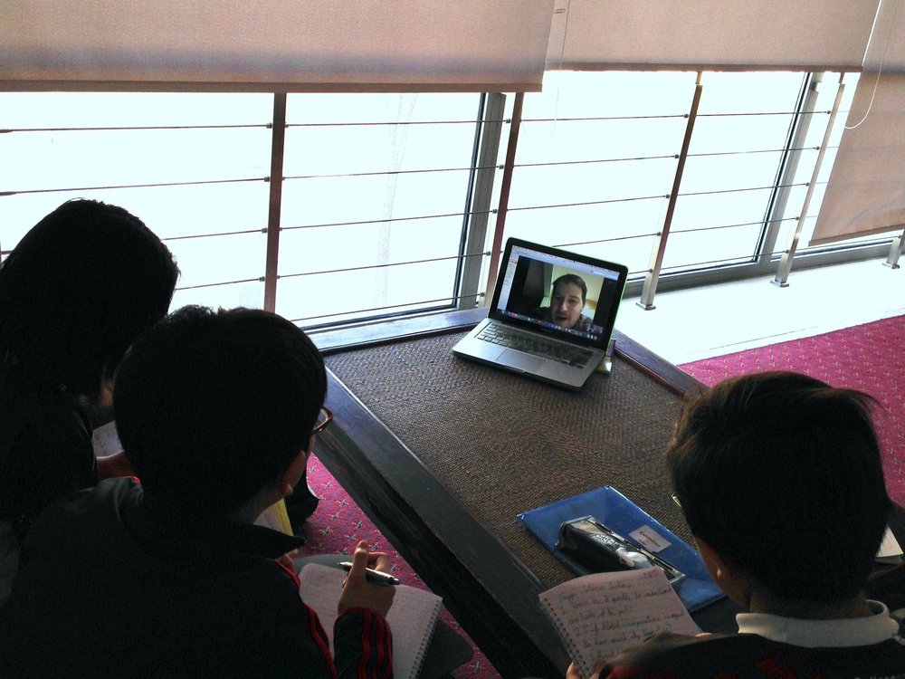 All eyes on Jason Briner. Students at the International School in Tianjin, China, learn about climate change from noted paleoclimatologist Jason Briner. Photo: Diana Garcia Lavigne