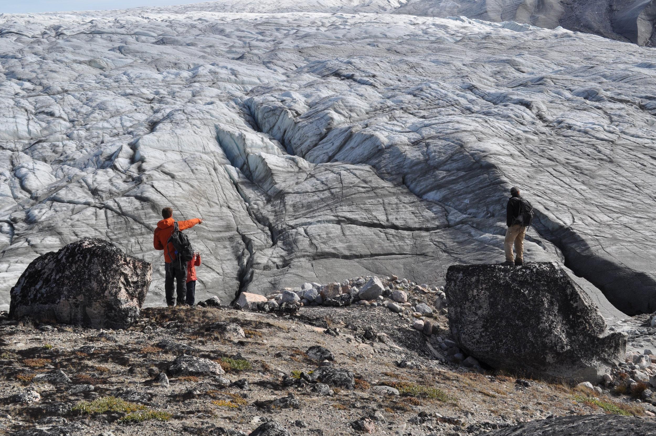 Nicolas Young (LDEO), Elizabeth Thomas (SUNY Buffalo) and Jason Briner (SUNY Buffalo) talk sampling strategies in front of the Greenland Ice Sheet. Photo: Sam Kelley