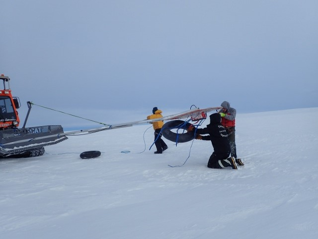 SCAT team adjusting GPR boom – mounted on an arm in front of the Tucker, it is our first method of crevasse detection. Photo: Robin Davies