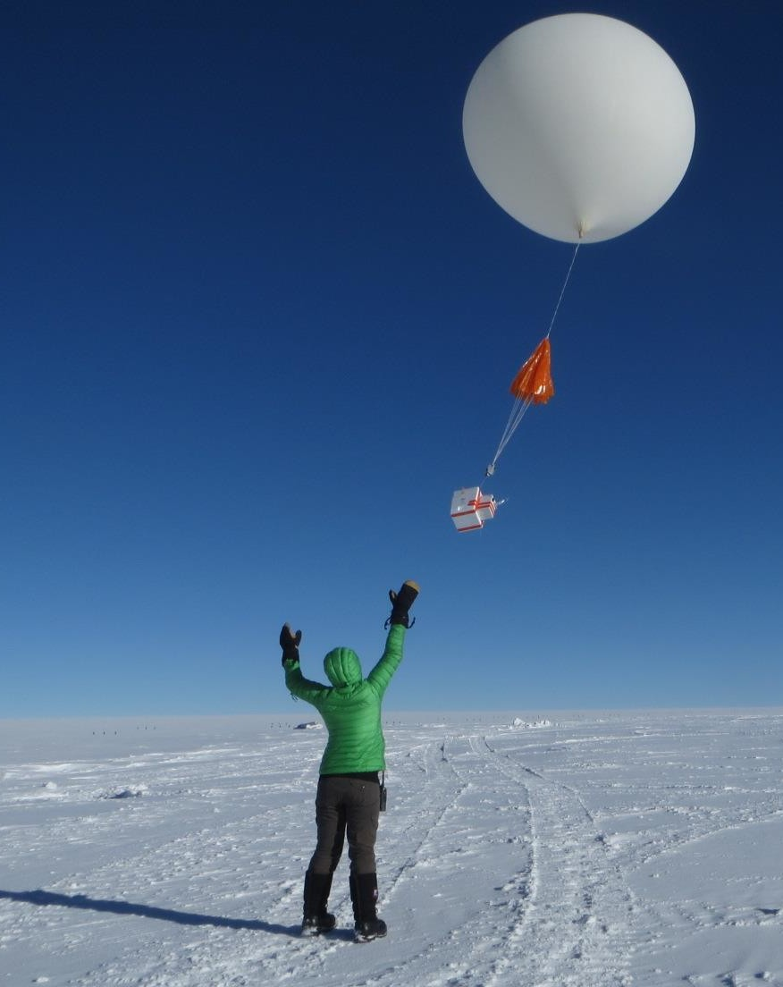 Launching a balloon with an instrument package to detect springtime atmospheric ozone levels--an ozonesonde--at Summit Station. Photo: Jason Johns