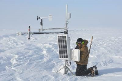 Ben Toth retrieving data card from a weather station. Photo: Robin Davies