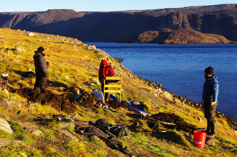 Researchers Hans Lennert, Hans Lange and Justin Junge excavate Late Dorset culture artifacts from Iita in Greenland. The site served as a crossroads for various paleo-Inuit cultures crossing into Greenland. Climate change is endangering its long-term viability, so archaeologists are racing against time to save what they can. Photo: John Darwent