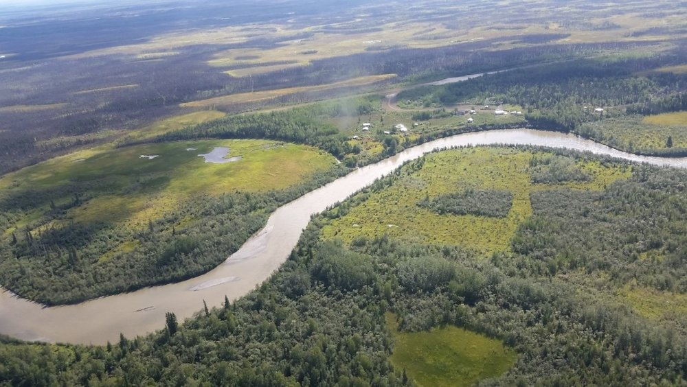 Aerial view of the Upper Kuskokwim River, with the community of Telida Village visible in the distance. Photo credit: Permafrost Laboratory.