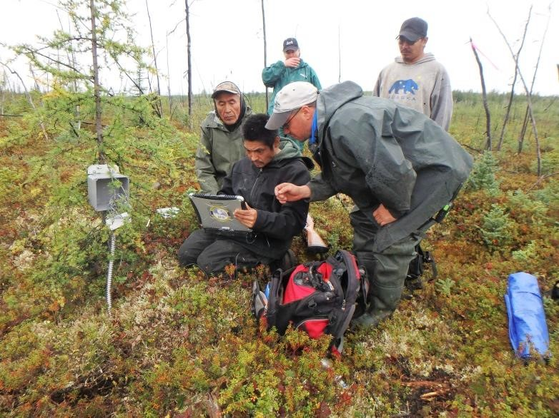 Following installation of a soil temperature data logger near Telida Village, community partners get hands-on training from Dr. Kholodov. Photo credit: Permafrost Laboratory.