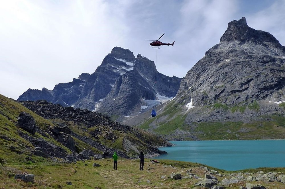 An Air Greenland helicopter delivers a sling load of equipment to a study site in south Greenland. Helicopter support is essential to the team's research.  Photo credit: Jamie McFarlin