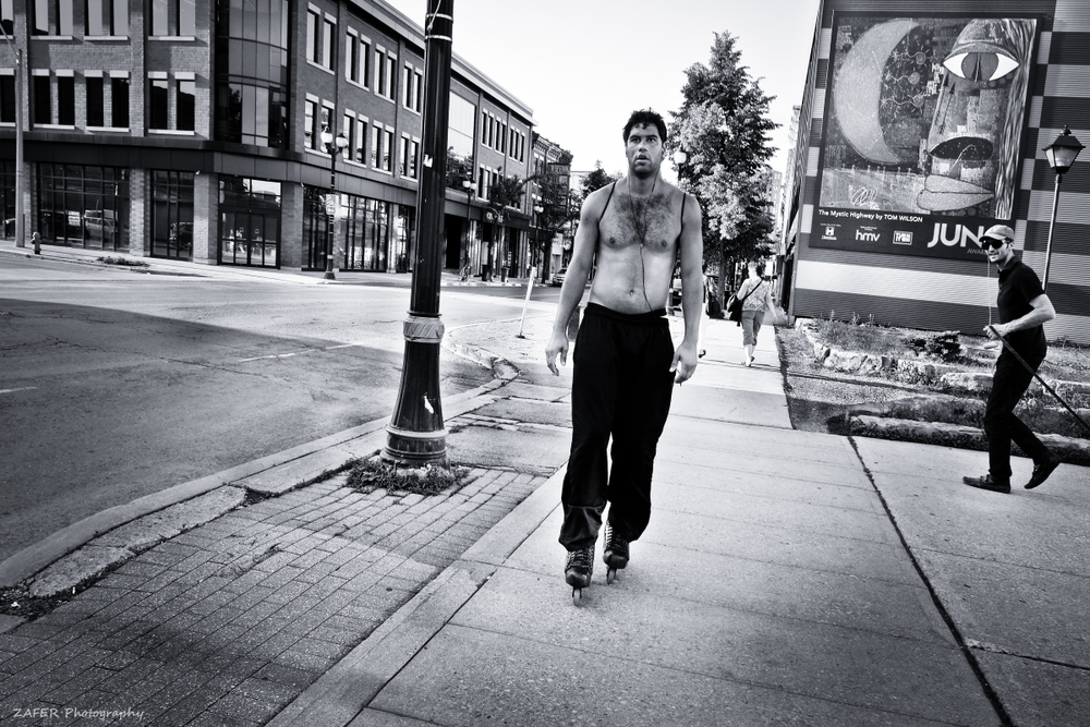 shirtless man on skates James North 1 sm.png