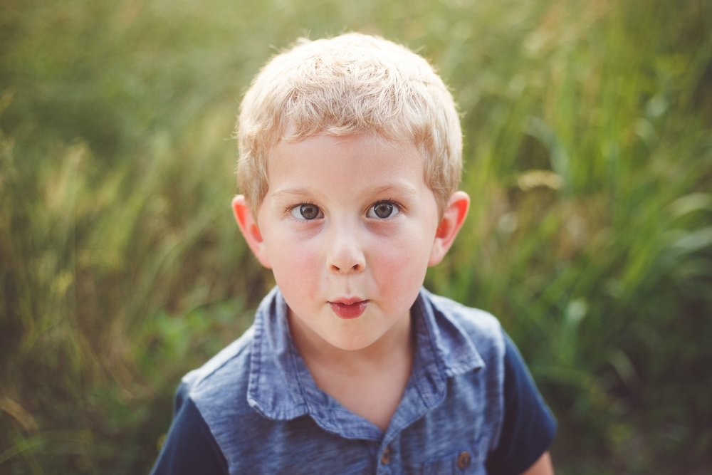 A young boy makes a playful face for the camera - Child Photography Session by L+R Photography - Tulsa, Oklahoma