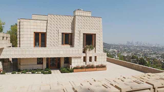 "ENNIS HOUSE, Los Angeles, 1924 📸: Still from S9 E1: That Far Corner - Frank Lloyd Wright in Los Angeles . Structural preservation challenges for FLW block structures. Studying failing structures in California face similar preservation challenges as FLW homes here in WI. {link in bio}. . ""The dirt used on site to create the home's textile blocks were built with aggregate of different sizes, making the resulting textile blocks incredibly porous. When it rains, the blocks ""soak up water like a sponge,"" says Sandmeier. The blocks are tied together with rebar, which adds risk when mixed with water.  When the rebar gets wet, it rusts; when rebar rusts, it expands; and when rebar expands, it shatters the blocks. As Sandmeier puts it: ""The house is slowly falling apart from the inside out."" That kind of decay happens to all the textile-block houses, not just the Freeman House, and Frank Lloyd Wright wasn't the only person to design with textile blocks. His son Lloyd Wright followed in his footsteps, designing several very famous textile block-houses, such as the Sowden House and the Samuel-Novarro House. . The question of preservation — how to keep the original integrity of the design while ensuring its place in the future — is repeatedly tested by remnants of Frank Lloyd Wright's legacy. When solutions are discovered and implemented at a Frank Lloyd Wright home, they improve the chances of preservation for many other historically-significant buildings in the region. . Good stewardship takes money, however, and both Sandmeier and Fine mention the need for more money to protect the works of Frank Lloyd Wright in Los Angeles. In the case of USC at the Freeman House, lack of funding leaves preservation in a state of academic limbo, which can be frustrating to well-intentioned preservationists. ""It would be more fun if we had more money,"" says Sandmeier. ""We can study it all we want. But until we can actually do some of this stuff, the house continues to decline."""