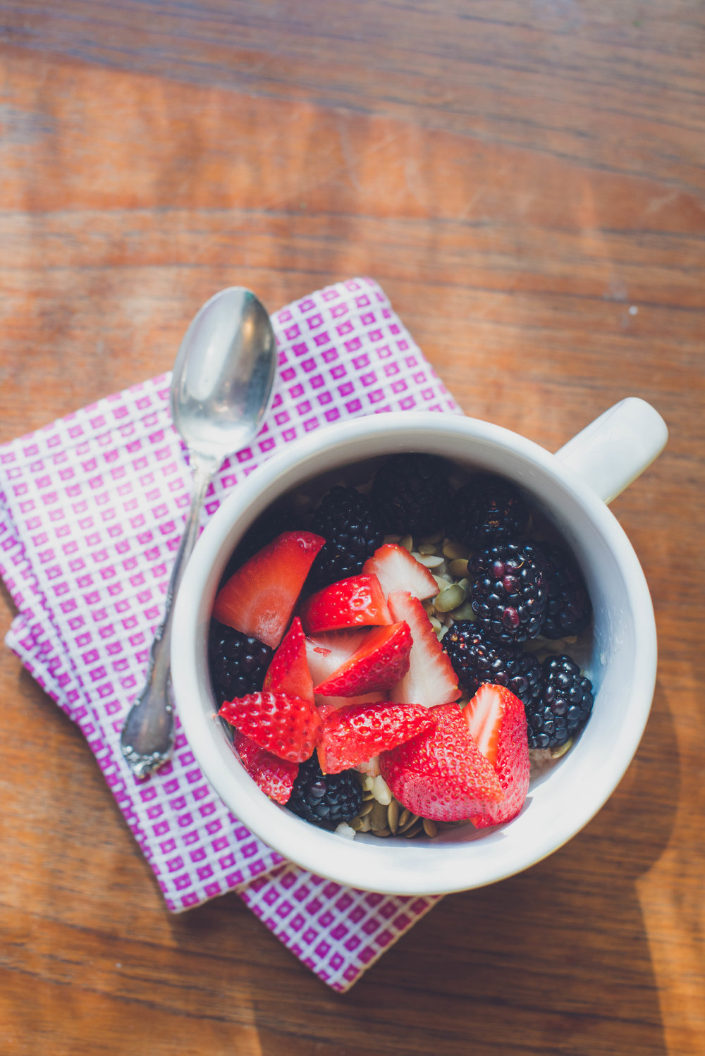 traditional oatmeal with berries and nuts