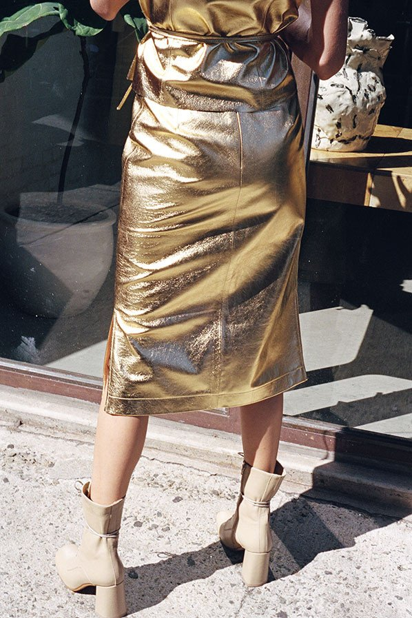 Maryam Nassir Zadeh Simona skirt in gold leather $1,380