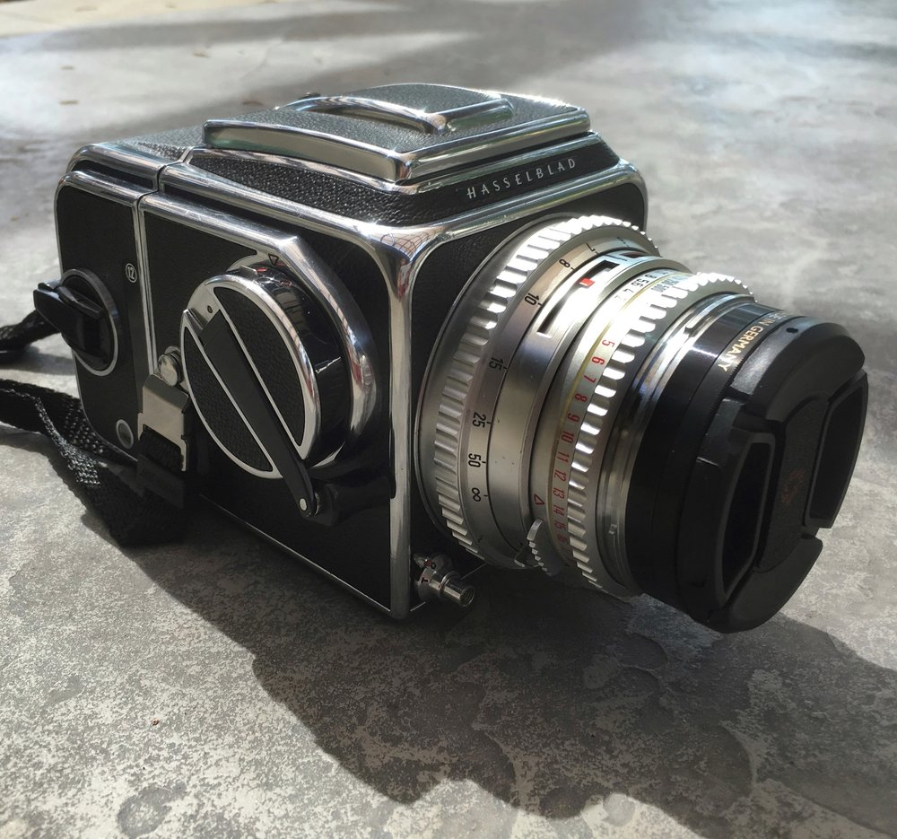 Iphone picture of Hasselblad 500c: These were first produced in 1957. This camera has interchangeable lenses and can exchange film backs, allowing the photographer to use multiple films at a time.