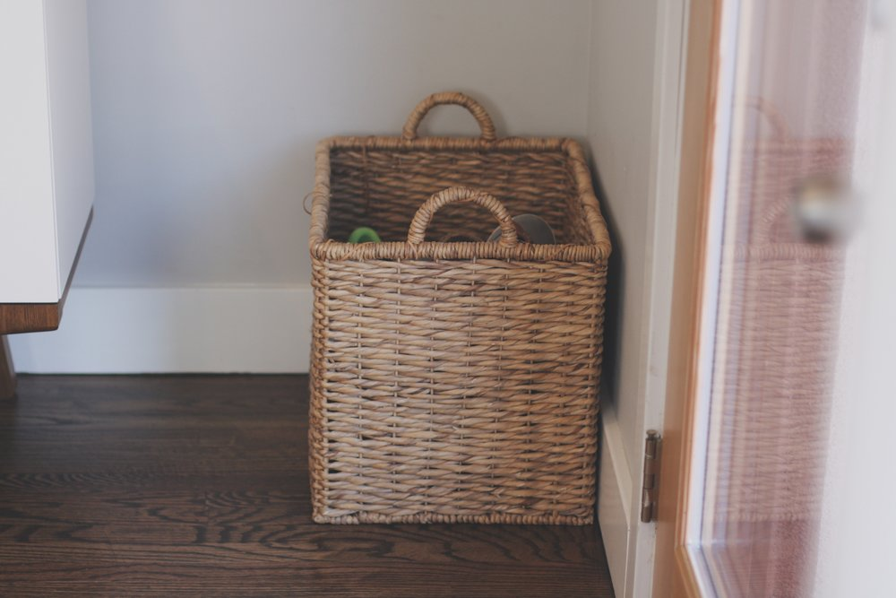Basket where shoes can hide next to our front door.