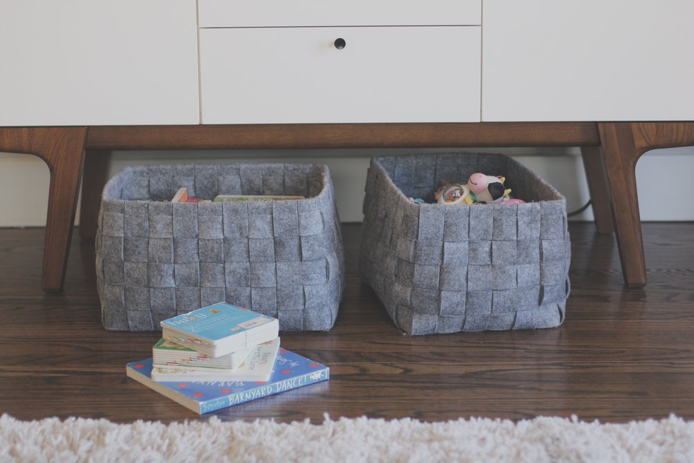 One basket is for small toys, the other is for Lola's baby books.