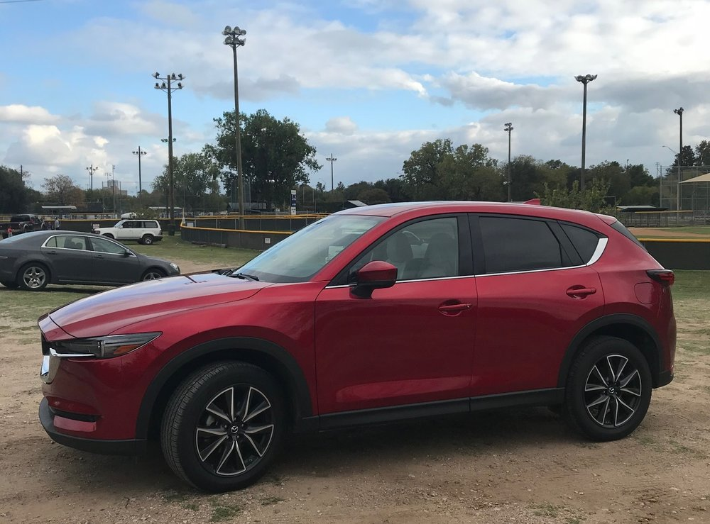 The Mazda company SUV goes everywhere... including Little League games!