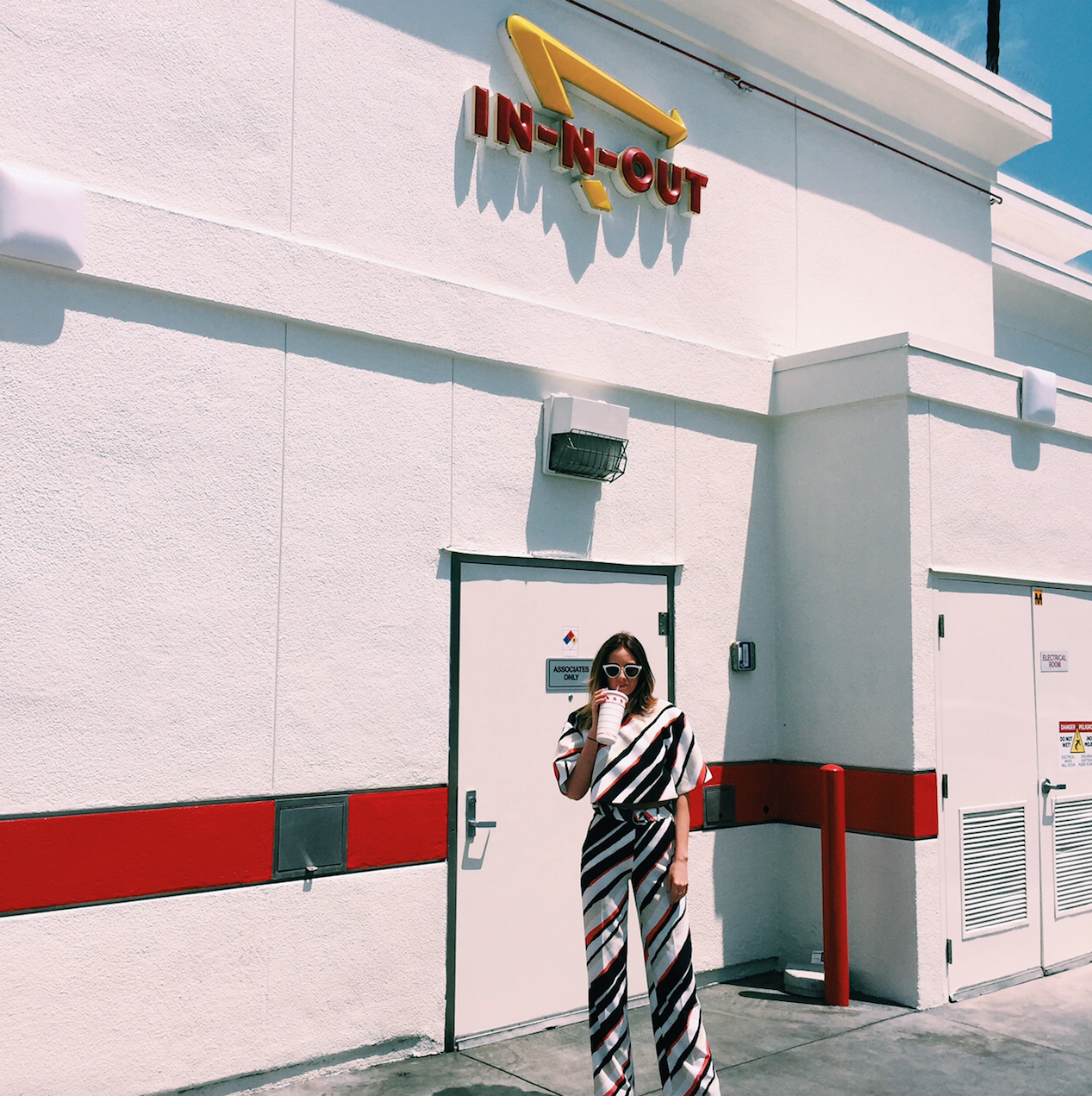 Kendall Sargeant wears C/MEO COLLECTIVE 'Wild World Pant and Higher Ground Top' at IN-N-OUT Burger, LA.