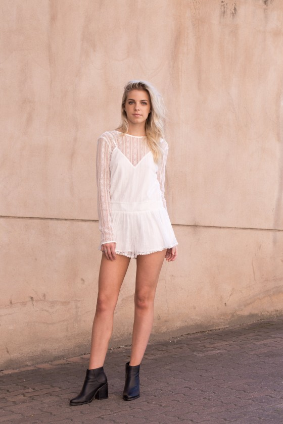 Dani wears The Fifth Label Little Secrets Playsuit.
