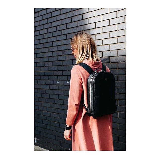 @stylememos wears the Mini Gloucester Rucksack in Glossy Black.