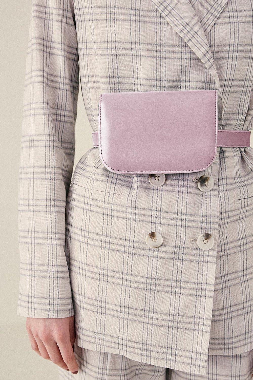 Shop JAGGAR The Label Belt Bag in lilac.
