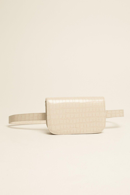 Shop JAGGAR The Label Belt Bag in cream.