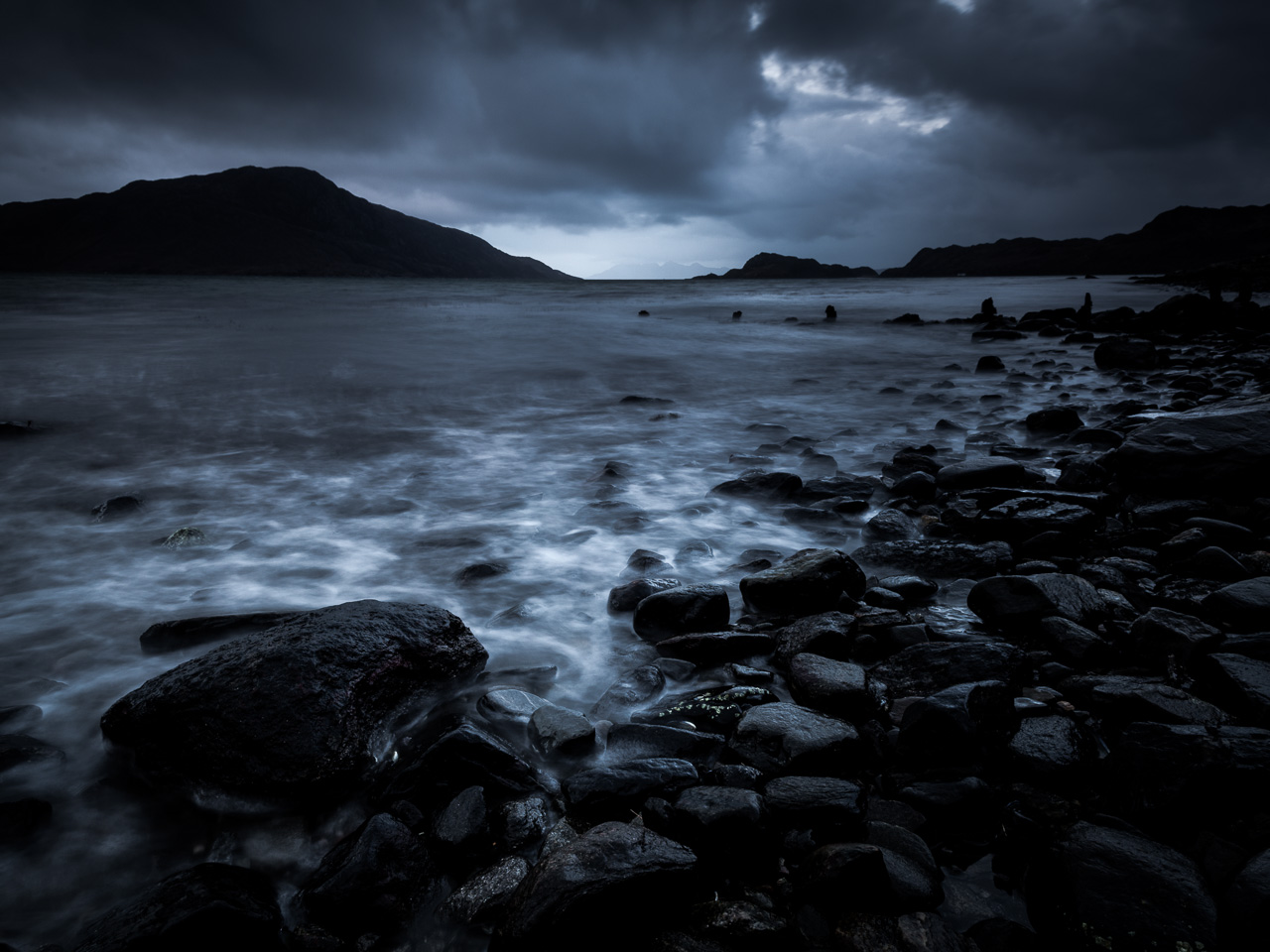 One of my favourite images from the trip. I love the overall dark mood with that hint of brightness drawing the eye towards the Rum Cuillins in the distance.
