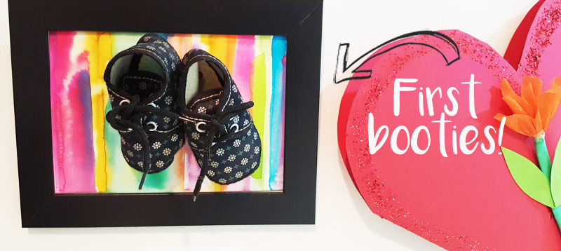 That's how I used the IKEA frame to display my kid's first booties!