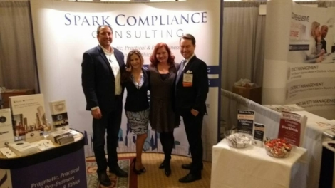 Spark Compliance's Ramsey Kazem, Diana Trevley, Kristy Grant-Hart and Jonathan Grant-Hart at the exhibition booth, Compliance and Ethics Institute, Las Vegas, 2017.