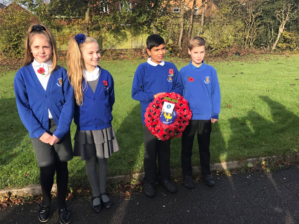 Year 6 pupils attend the Remembrance service at St John's Church, Essington.