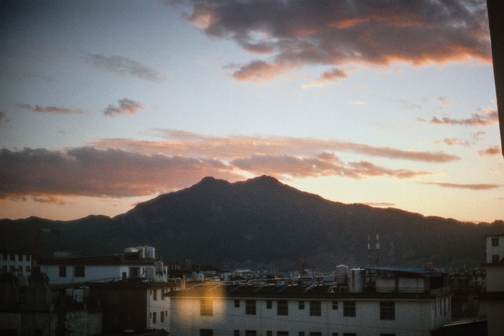 Sunset over the rooftops of Lijiang