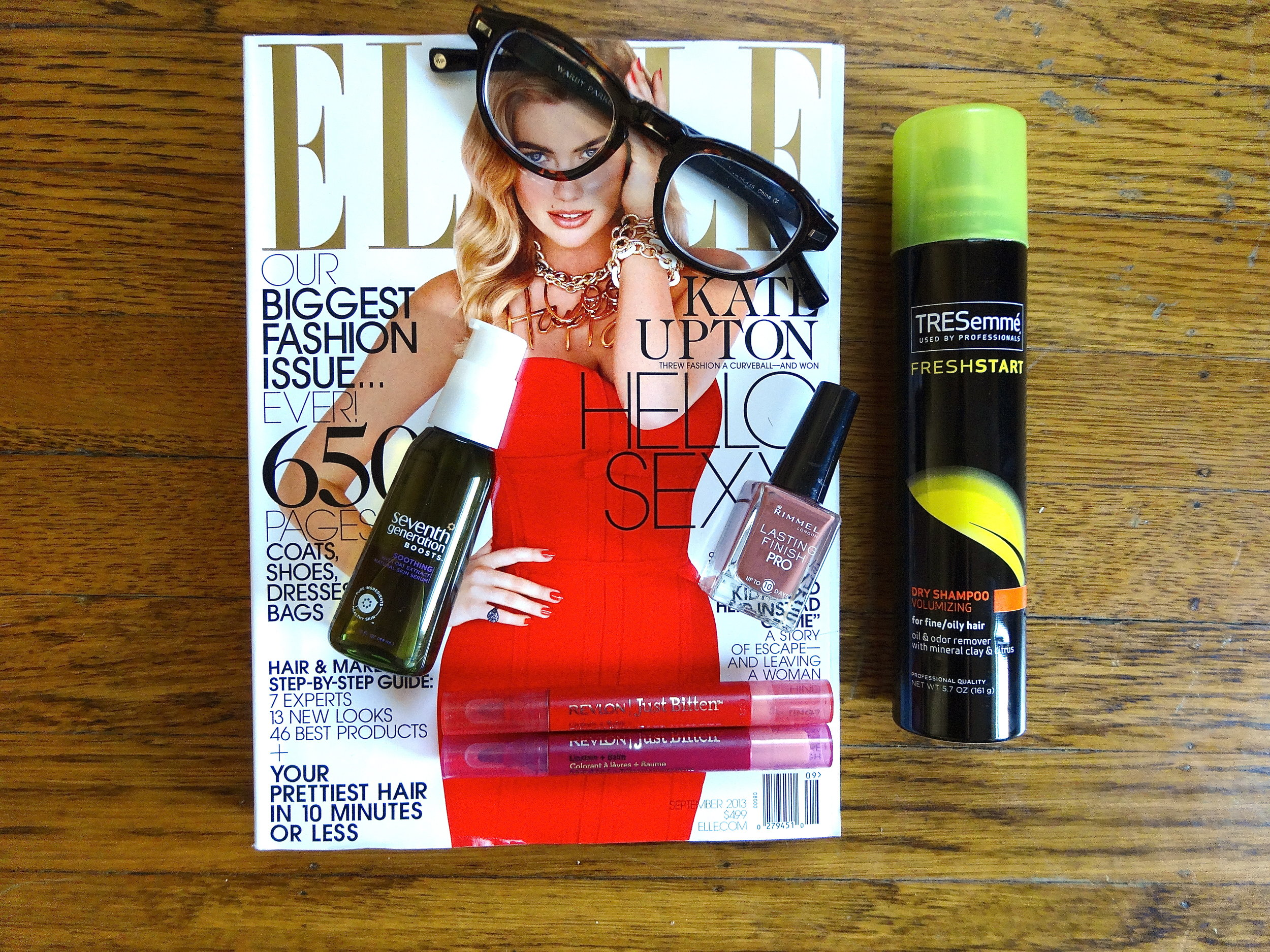 L to R: September Issue of Elle Magazine, Warby Parker Glasses, Tresemme Dry Shamoo, Rimmel Lasting Finish Nail Polish, Seventh Generation Boost Serum.