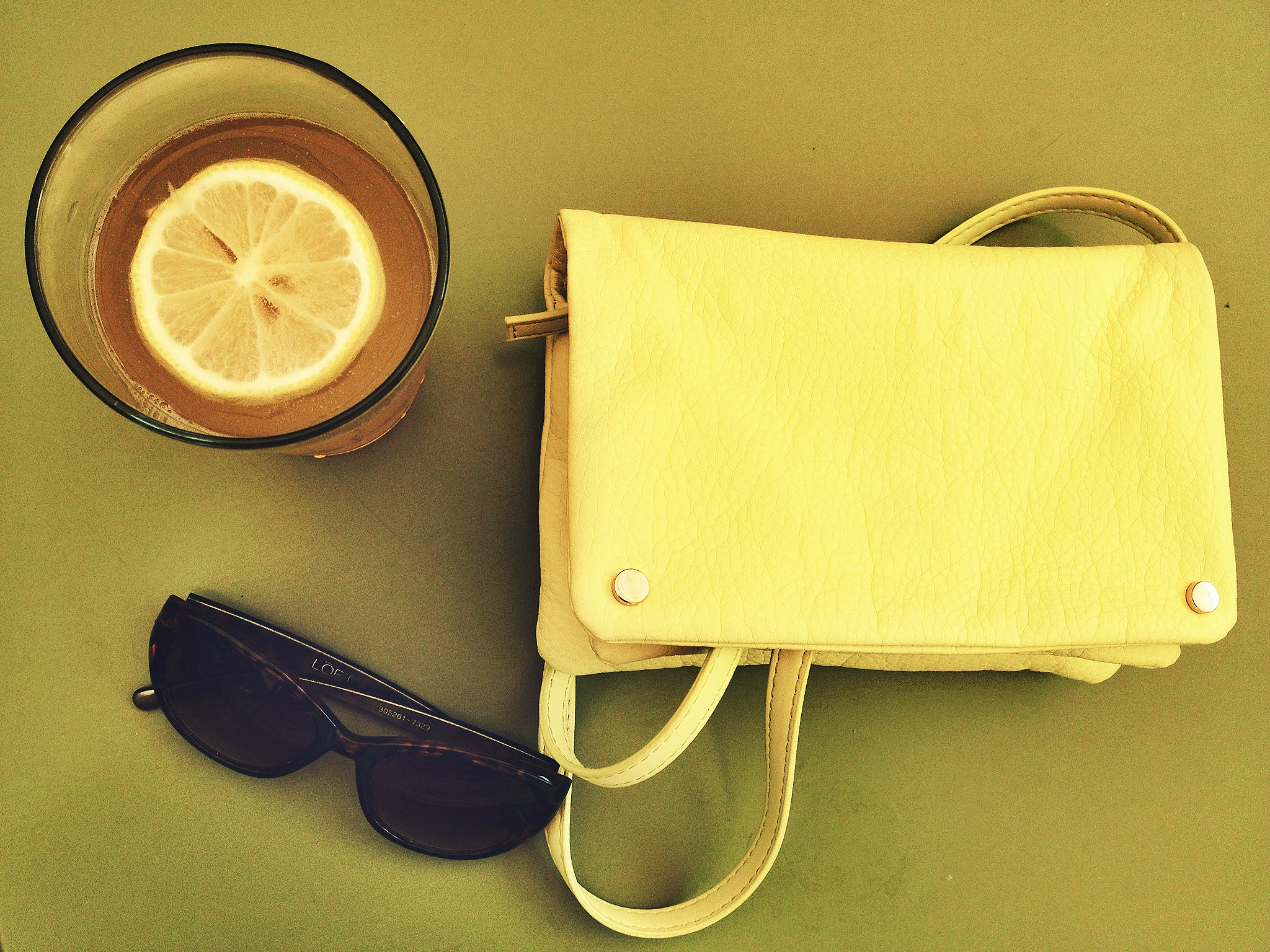 Keepin' cool with sunnies, beer and a killer bag.