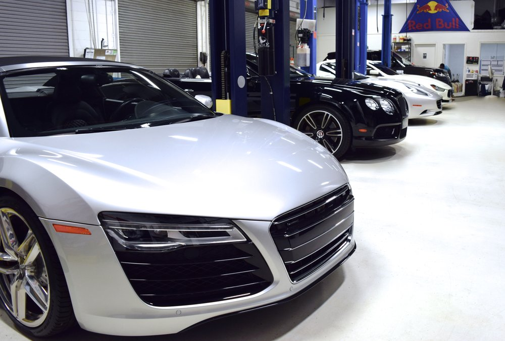 Three high end exotic cars in for maintenance.