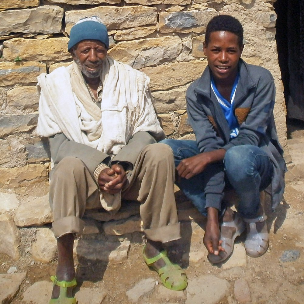 80-year-old Hadush Teferi Gebrihet and his 17-year-old grandson Gebretsadikan Weldu live in the village of Adiharena in the eastern part of Tigray region.
