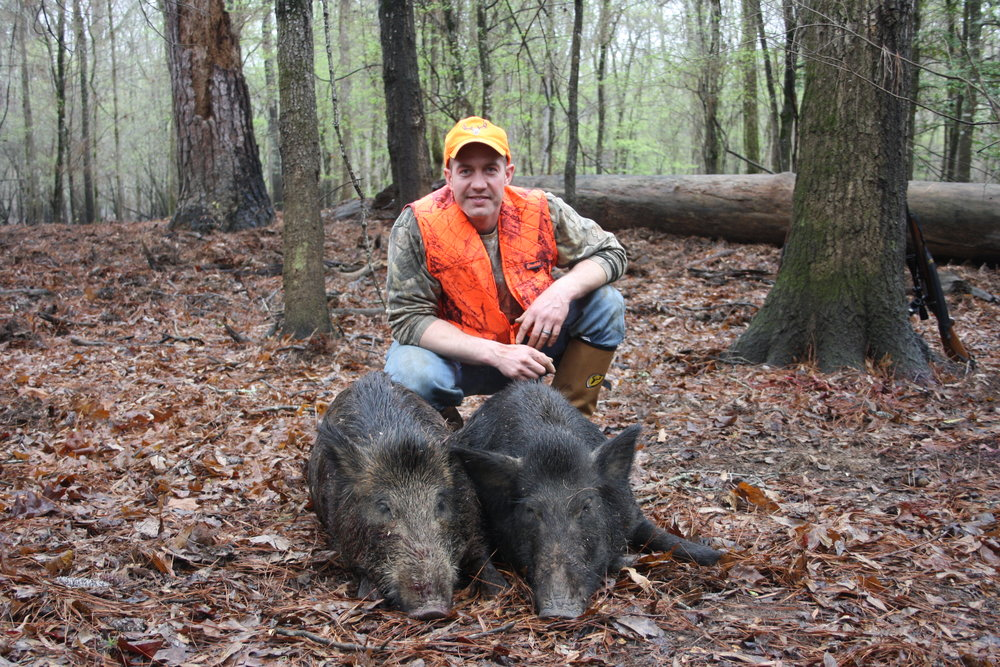 Dan with his first two pigs