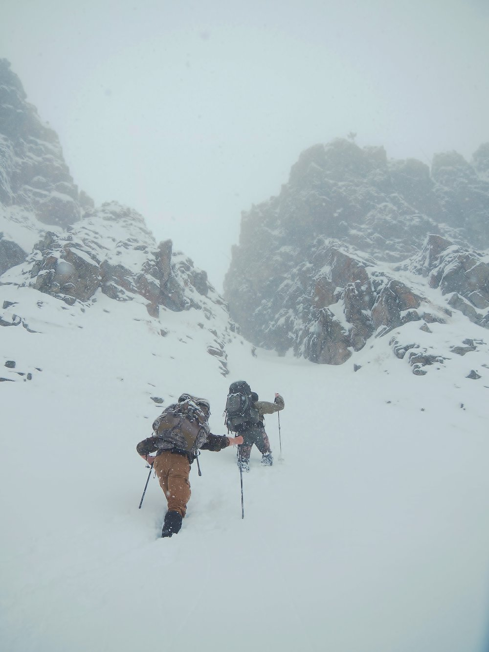The brave souls (Dakota and Steve) making their way to the mouth of an unexpected couloir in the Shoshone National Forest.
