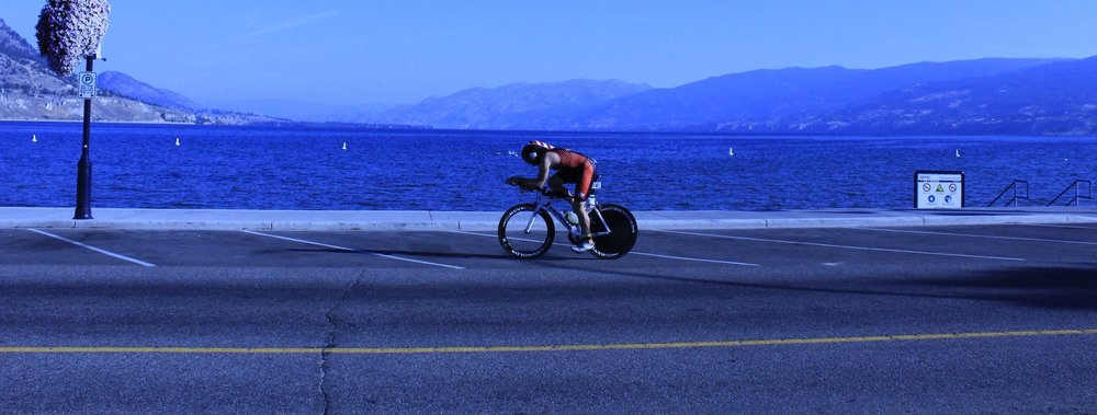 Penticton ITU Multisport World Championship Cyclist on the boardwalk
