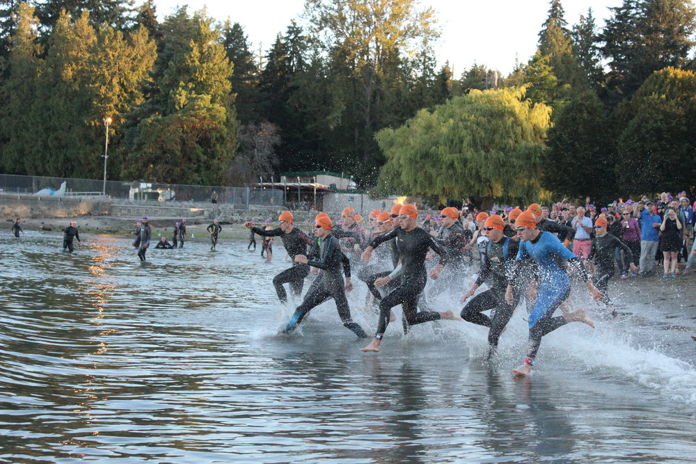 The Junior Men racing into the Pacific Ocean at the Vancouver Triathlon in Stanley Park.