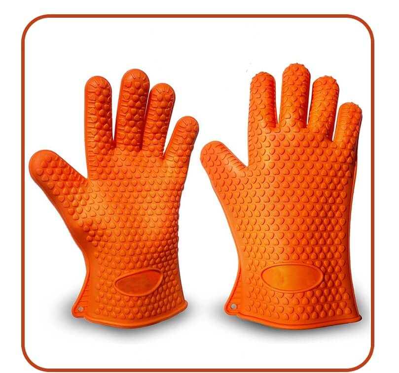 A product photography captured by Virtuous Graphics which is two orange gloves on a white background.