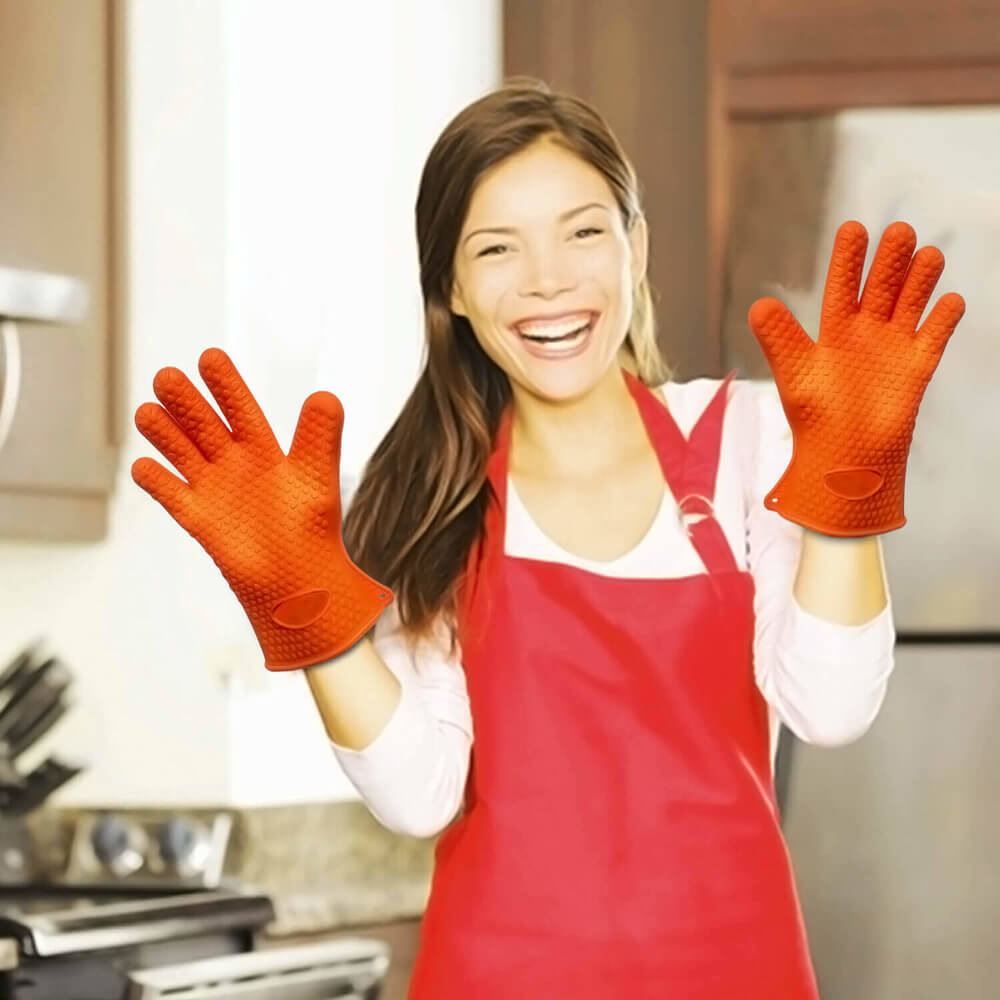 Amazon product photography of a woman in her 40's in the kitchen happy smiling while wearing orange gloves.