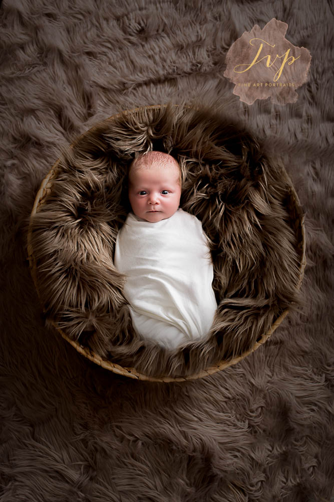 wrapped newborn in basket