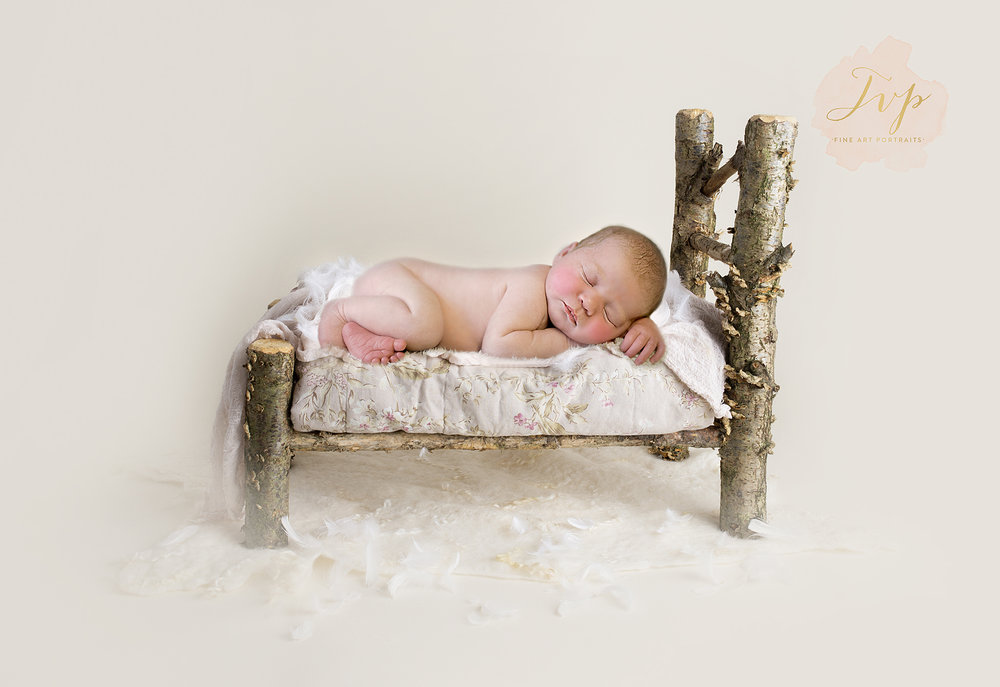 newborn-photographer-near-me-baby-sleeping-on-bed