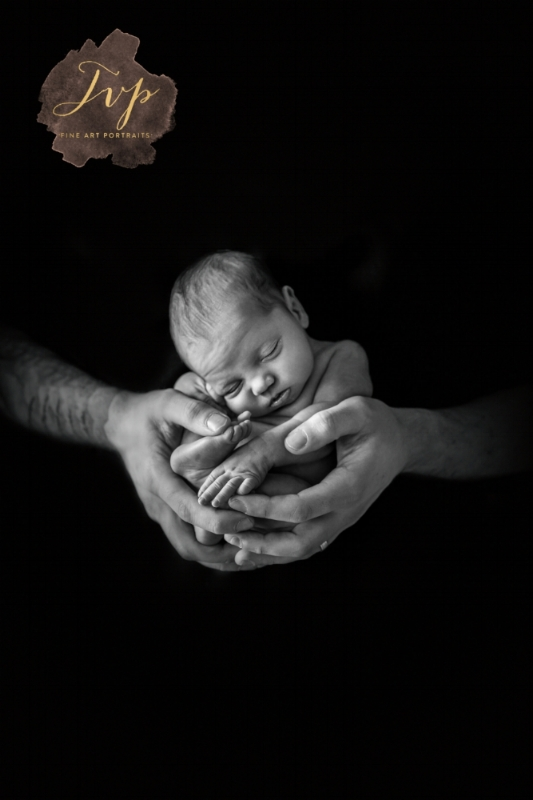 Safe in hands, newborn photographer Glasgow