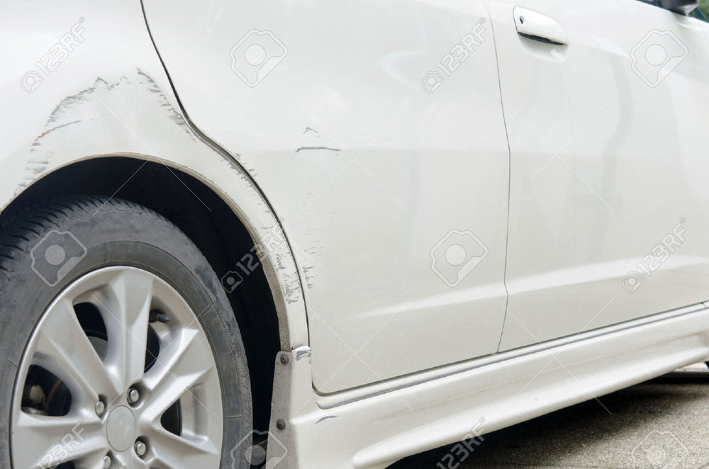 29714081-Car-paint-scratched-at-the-door-and-the-rubber-out-of-focus--Stock-Photo.jpg
