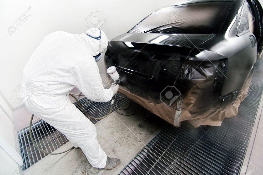 24477584-Worker-painting-a-car-in-garage-using-an-airbrush-gun-Stock-Photo.jpg