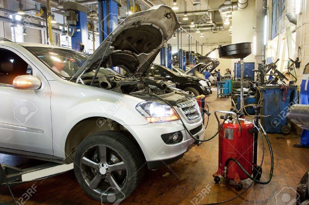 13796078-The-car-in-a-repair-garage-Stock-Photo-auto.jpg