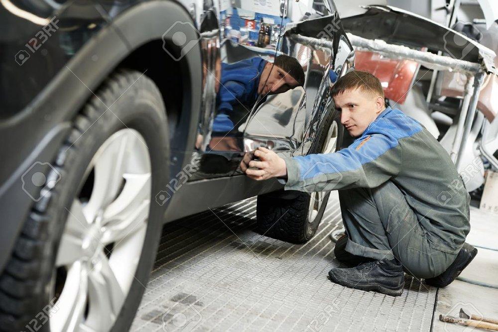 18411749-automobile-car-body-paint-check-Stock-Photo-car-repair-auto.jpg