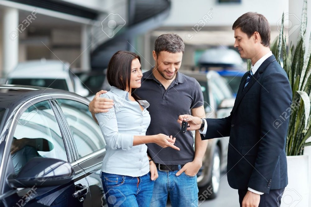 16058591-Young-couple-buys-a-car-Stock-Photo-car-rental-new.jpg