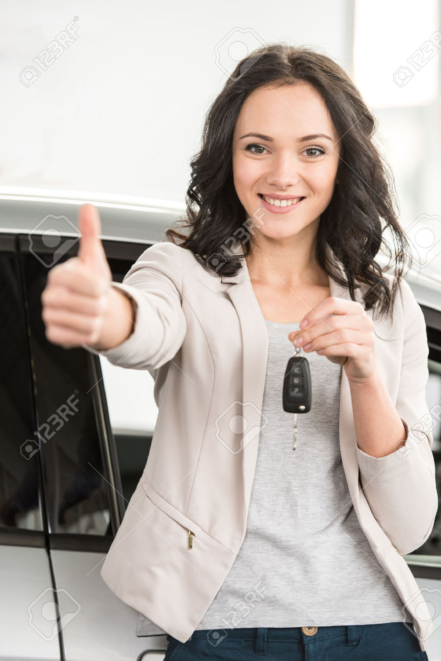 35322414-Happy-young-woman-is-holding-keys-to-new-car-and-looking-at-the-camera--Stock-Photo.jpg
