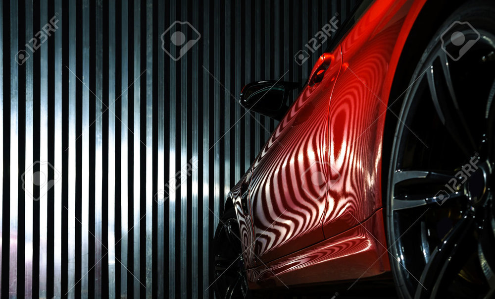 32067986-Luxury-red-car-details-view-elegant-and-beautiful-Stock-Photo.jpg