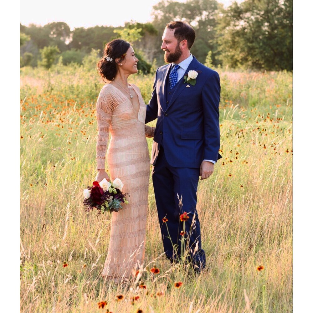 kim and her husband adam on their wedding